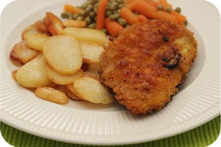 Krokante Schnitzel met Aardappelschijfjes en Doperwtjes