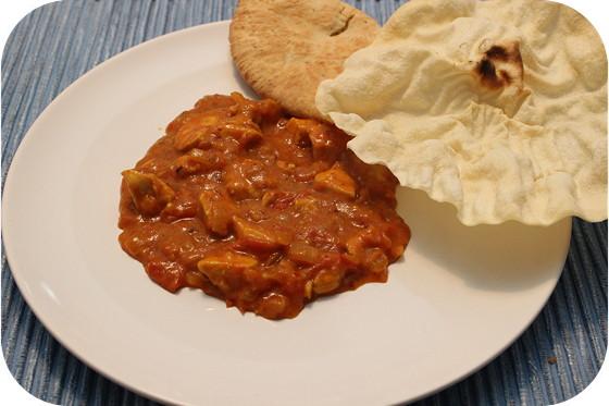 Kipcurry met Naanbrood en Pappadums
